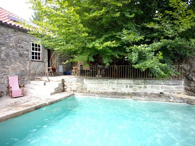 Photo for Peaceful country cottage with pool