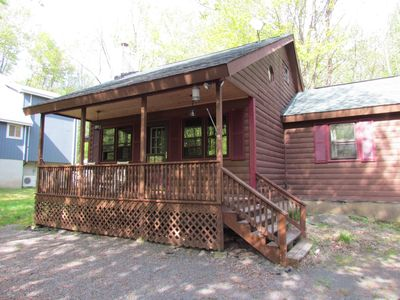 Photo for Cozy Log Sided Cabin Walking Distance to Beach and Pool