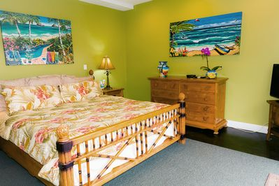 Spacious bedroom for relaxing on this king size bed with ceiling fan & A/C unit.