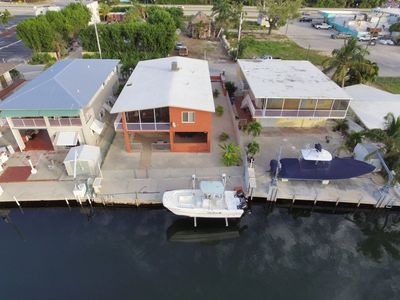 Photo for Canalside Retreat in Popular Plantation Key  months open..