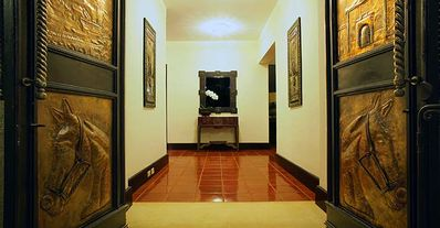 The dramatic entrance boasts a 20ft. door, with bronze plaques commemorating family and local history.