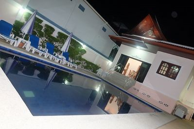Majestic Villas 1, 2 bedroom. Pool area at night time.