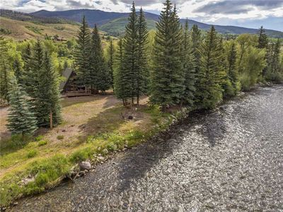 Photo for Secluded Cabin On The Blue River in Silverthorne, Big Deck, Fishing, Easy Drive to Town and Resorts