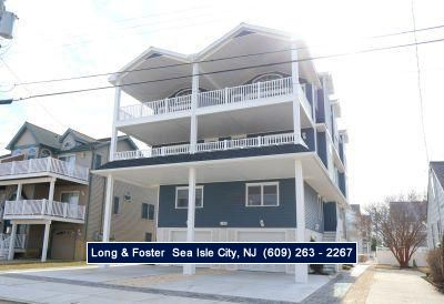 Photo for SHORT walk to the beach! This magnificent home features three levels.