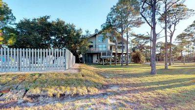 """Photo for No Hurricane Damage!  Gorgeous Sunsets, Easy State Park Access! Private Pool, Fishing Pier, Fireplace, Beach Gear, 3BR/2BA """"Ambitions At Bay"""""""