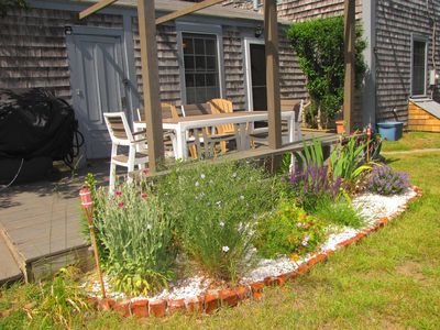 Enjoy dining on the deck. There is a table, bench seating, chairs and gas grill