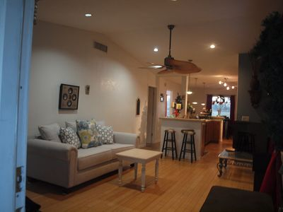 Living room, open kitchen and dining area overlooking beautiful water view!