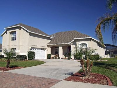 Photo for Lakefront Luxury, 2 miles to Disney with Spa, Games Room, Wi-Fi, 60 ' TV