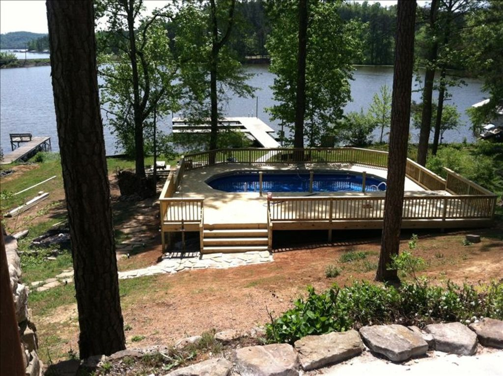 Looks rustic but luxury awaits you at two cabins lodge lakefront with pool lake guntersville for Cottages in the lakes with swimming pools