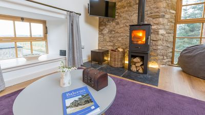Log burning stove in the lounge area,easy to light and keeps you cosy, Smart Tv