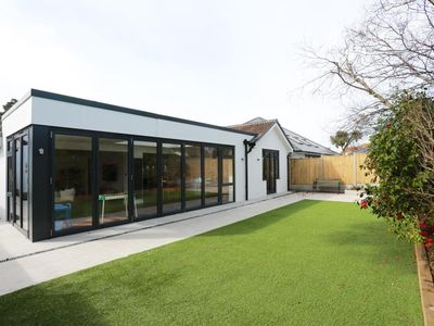 Photo for BOURNECOAST: MODERN BUNGALOW - IDEAL FOR FAMILIES - LARGE BIFOLD DOORS - HB5811