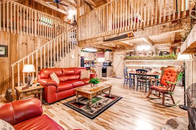 Living Room Features Leather Furniture, Wood-Burning Fireplace, Large Windows!