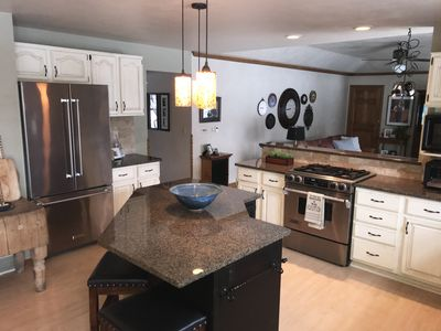 Large kitchen with granite island and countertops