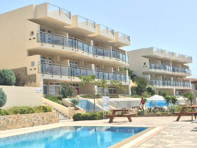 Photo for Poolside apartment with private outdoor hottub and terrace, 200m from the beach