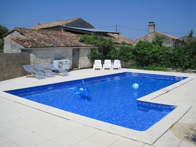 The shared swimming pool at Les Hiboux gites