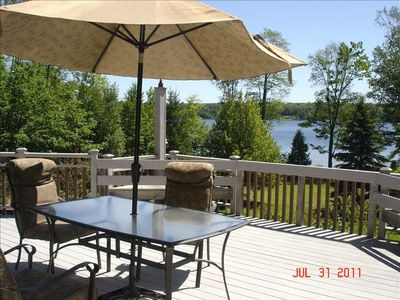 Fully furnished deck overlooking the beautiful lake