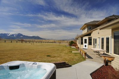 There is a great deck with a hot tub and views of the mountains.