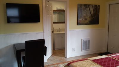 Bathroom - TV and dining table for your enjoyment.