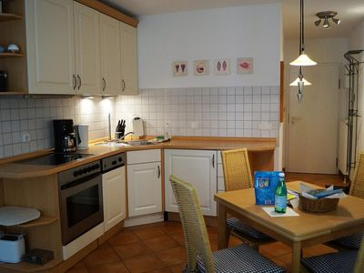 Photo for Tastefully furnished apartment with a beautiful sheltered south-facing terrace. With two bicycles and two flat-screen televisions you are ready for any weather in this beautiful holiday home.