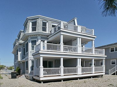 Photo for BEACHFRONT! This well-appointed 5 bedroom, 4 1/2 bath townhome features decks on all three levels