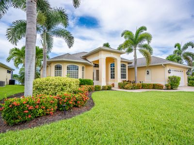 Photo for Introducing Infinity Dream Oasis! 3 Bed 2 Bath Luxury Pool Home Salt Water Canal