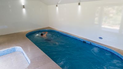Beautifully appointed heated indoor Swimspa  with swim against counter flow jets