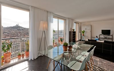 Photo for Spacious loft overlooking the city ...