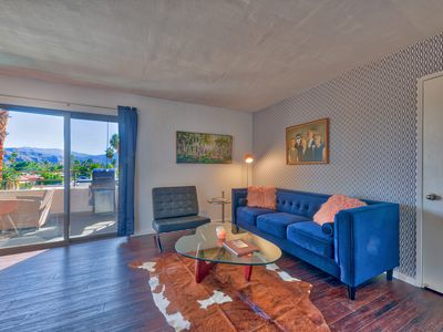 Photo for Stylish condo, centrally located with great mountain views and a huge veranda.