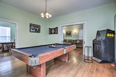 The game room includes a pool table and arcade game.