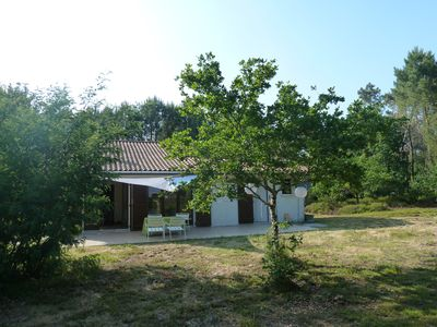 Photo for Comfortable house, in lush greenery, 5 minutes from ocean beaches