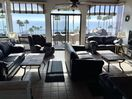 Our living room has great ocean views with 2 couches, 3 love seats and recliner.