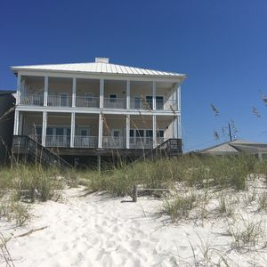 Exceptional beach house that sleeps 10-12. Step off balcony to sugar white sand.