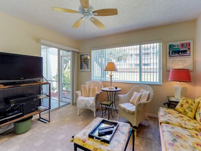 Photo for NEW LISTING! Conveniently located condo w/shared pool & tennis-walk to the beach