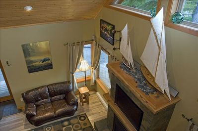 Model sail boats above TV and fireplace.