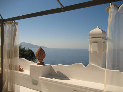 Large solarium overlooking Capri and the bay of Naples; outdoor furniture