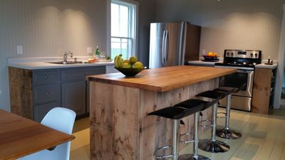 Century Old Wood from Reno wraps the Island