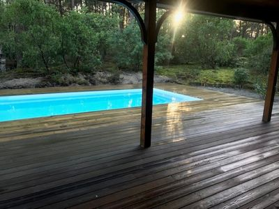"Photo for ""Sea Pines & Sun"" - Quiet wooden house at the edge of the forest with heated pool"