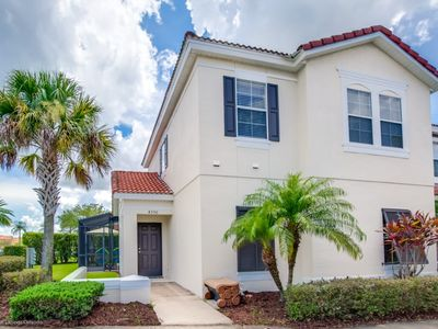 Photo for Spa like 4 bed town home with full size pool Close to Disney