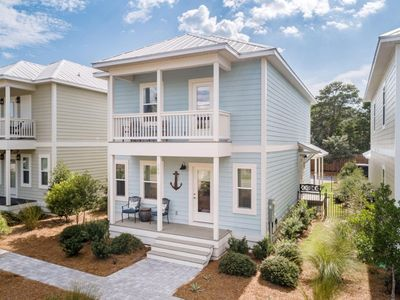 Photo for SATINWOOD RETREAT | Golf Cart | Short walk to the beach