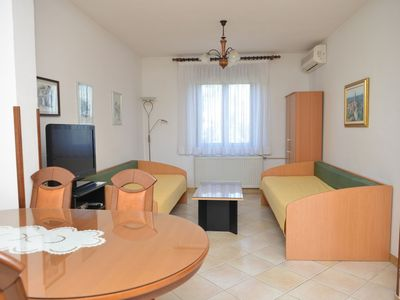 Photo for Bright apartment near the sea in Umag, with barbecue, garden, WiFi, AC