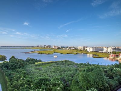 Photo for Sunset Island Condo w/ Bay View - Wi-Fi, Pools, Clubhouse, Private Beach & More!