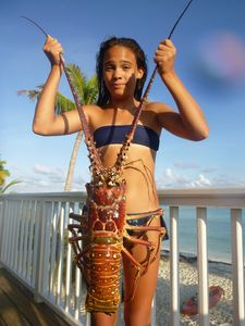 Sofia and a GIANT lobster speared on the reefs at Casuarina Point - August 2015