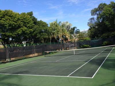 One 0f the 2 tennis courts inside complex