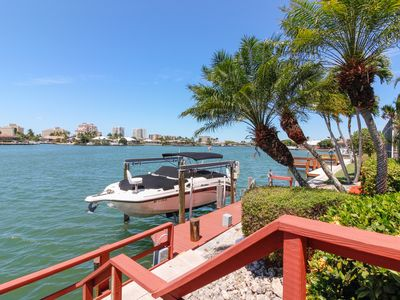 Photo for Waterfront ranch home w/ dock and a screened-in pool. Just minutes to beaches!