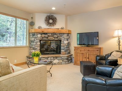 Photo for Bright, corner condo on Trail Creek with shared hot tub and shuttle access