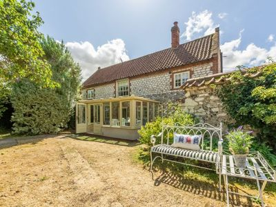 Photo for Chestnut Cottage is a Grade II listed flint cottage stylishly furnished