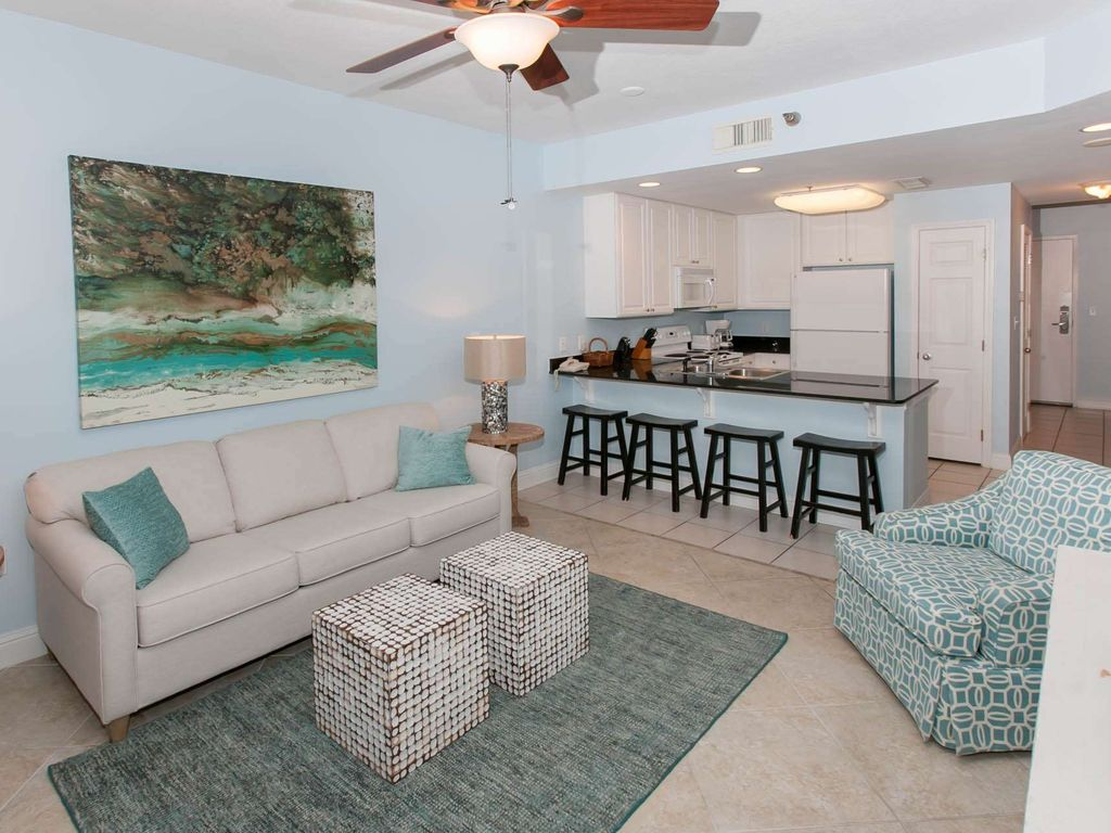 Lighthouse 1102 free golf fishing homeaway gulf shores living room with ceiling fan looking into kitchen aloadofball Image collections