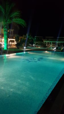 Pool at night, Restaurant In Background. July 2019