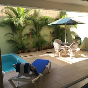 Shared back patio/pool, private and quiet.