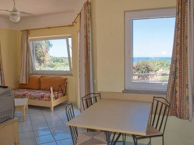 Photo for Calarossa apartment in Canneddi with WiFi, private parking & private roof terrace.